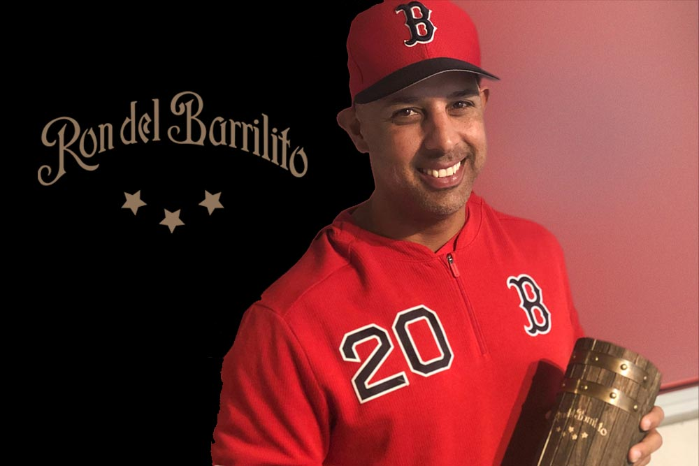 A gift of Ron del Barrilito Rum to Alex Cora